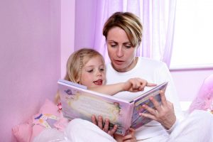 early reading - mom reading with daughter