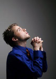 man praying to reduce stress