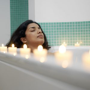 woman soaking in tub to reduce stress