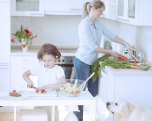 Mother and Daughter preparing healthy meal in kitchen - benefit of homeschooling