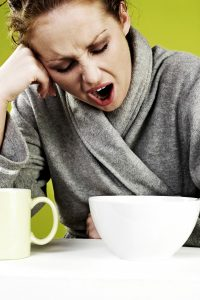 woman yawning - problem with oversleeping